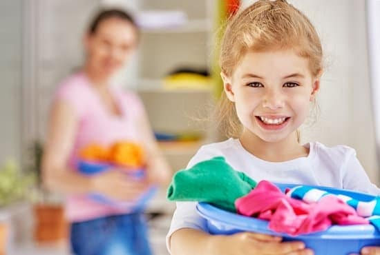 Girl helping her mom clean.