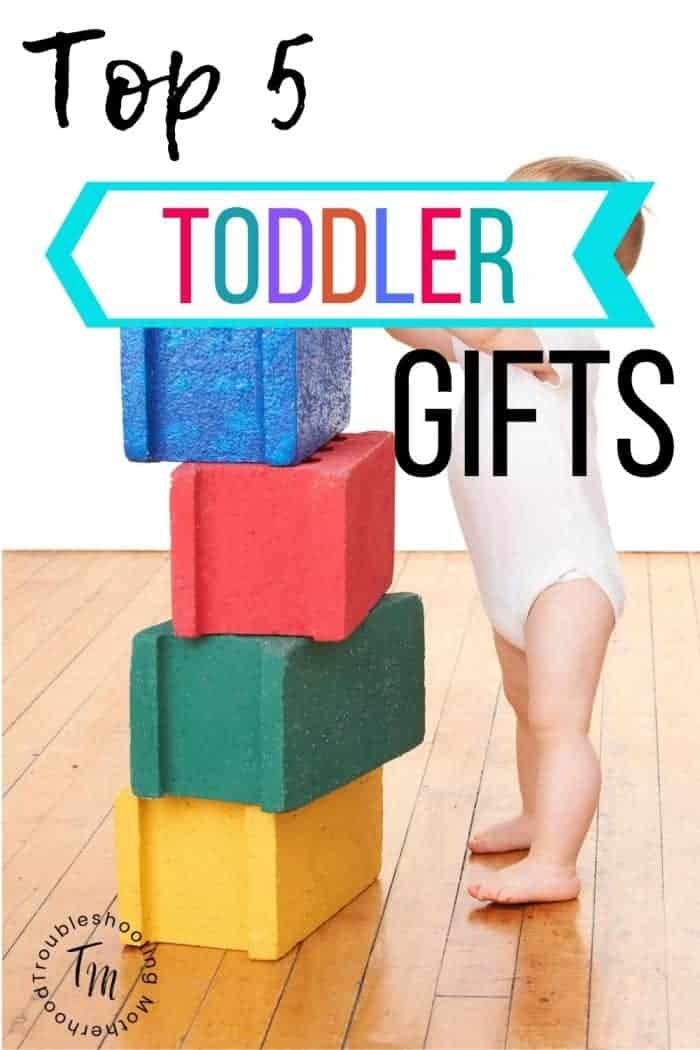 Top toddler gifts, toddler playing with foam blocks.