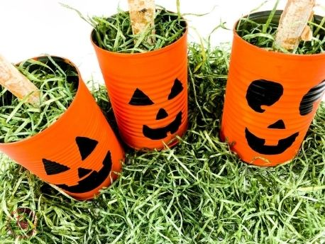 Completed project of three tin can jack o lanterns for Halloween craft project.