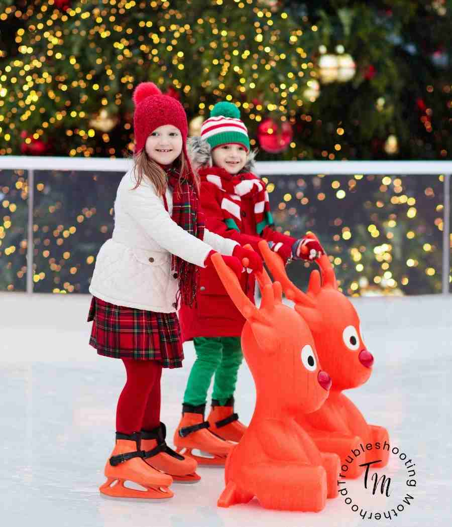 Little girls at an outdoor ice skating rink.