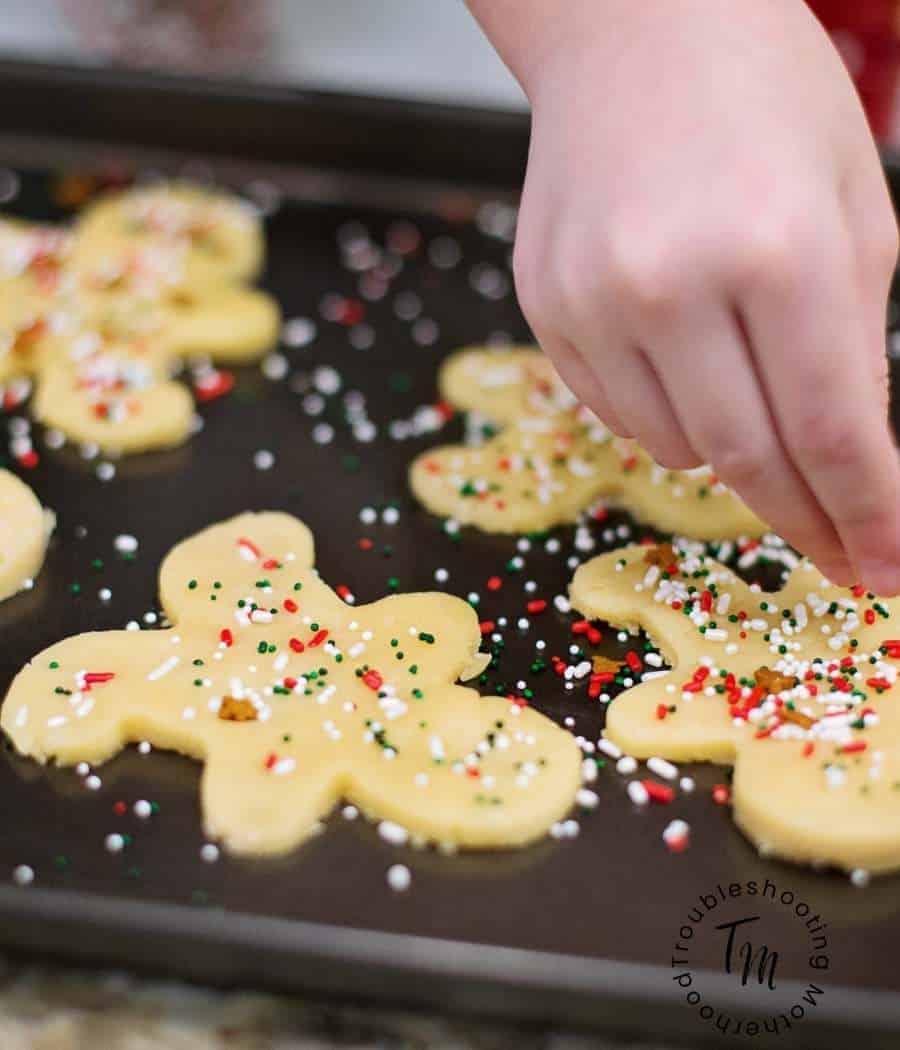 Baking homemade sugar cookies with sprinkles on top.