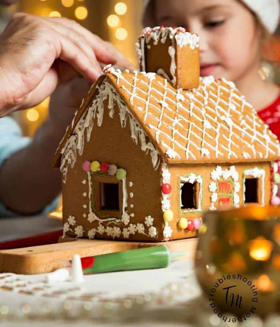 Children decorating a Gingerbread house.